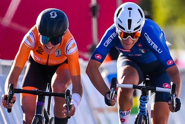 <p>Annemiek van Vleuten and Elisa Longo Borghini sprint to cross the finish line at the Women's Elite Road Race</p>