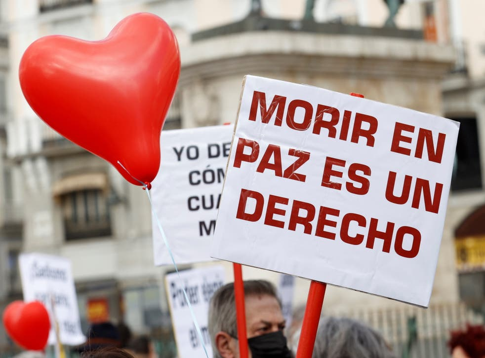 Members of the association 'Derecho a Morir Dignamente' ('Right to die with dignity') rally at the Puerta del Sol in Madrid