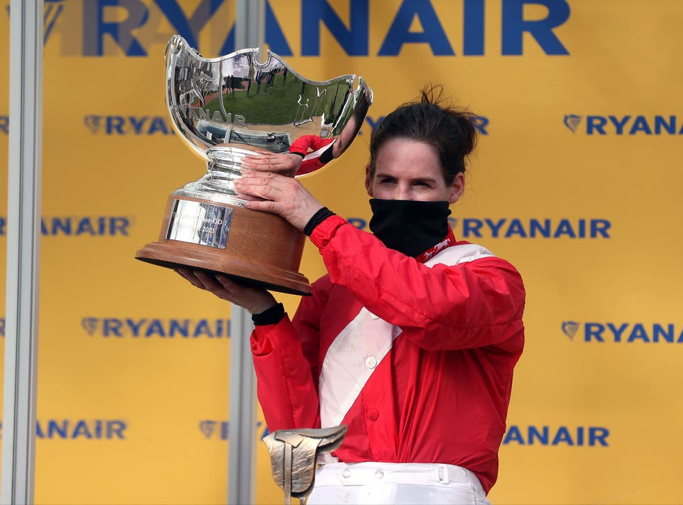Rachael Blackmore celebrates with the trophy after winning the Ryanair Chase