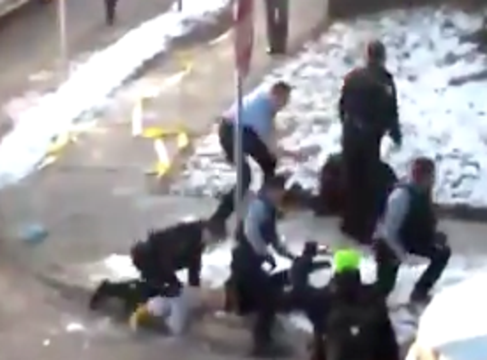 <p>A Minneapolis police officer appears to kneel on a demonstrator's neck during a violent clash on Thursday morning.</p>
