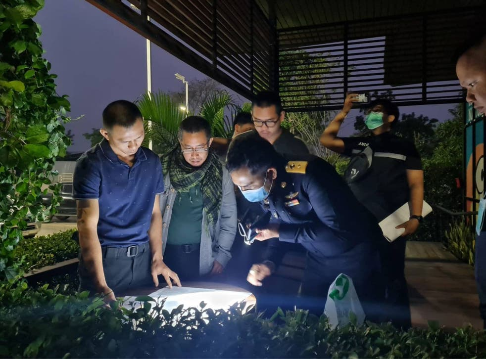 Thai authorities look at documents found during the operation against the syndicate