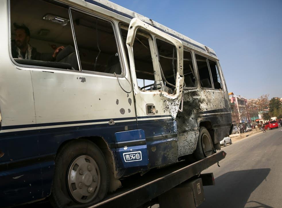<p>A roadside bomb hit a bus on Thursday, killing four</p>