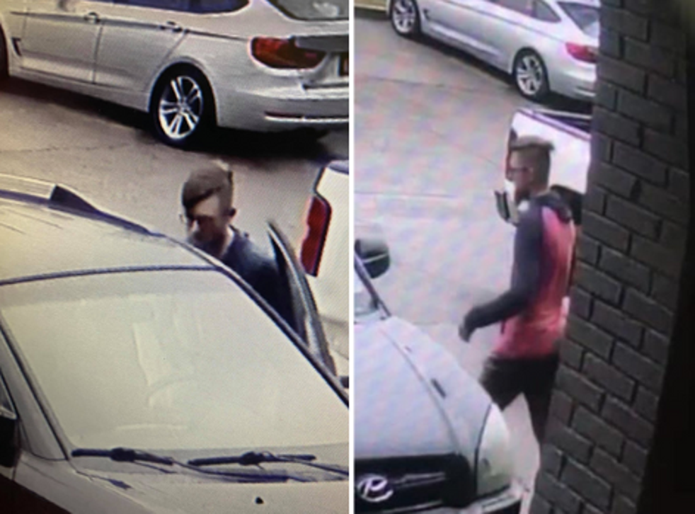 <p>Security footage released by the Cherokee Sheriff's Office in Georgia shows the 21-year-old suspect, Robert Long, getting into a car</p>
