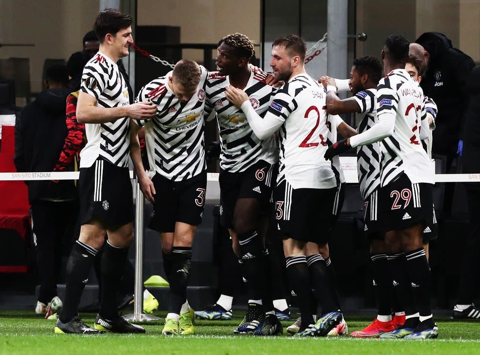 United celebrate Paul Pogba's winning goal in Milan