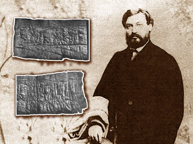 <p>Moses Wilhelm Shapira with two fragments of the <em>Scrolls</em></p>