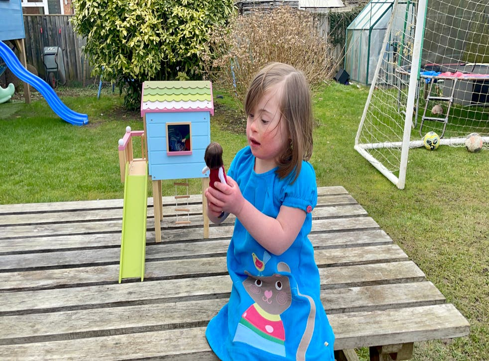 Rosie Barnett, 6, with a new Lottie Dolls toy that is inspired by her