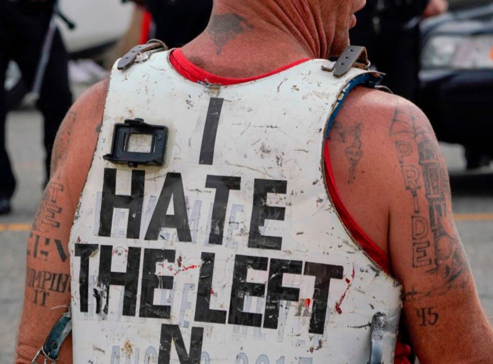 """A Trump supporter wearing a """"White Pride"""" tattoo and a hate message for The Left in August 2020. A new study claims that far right movements are seeking to co-opt environmentalism to push anti-immigration views"""