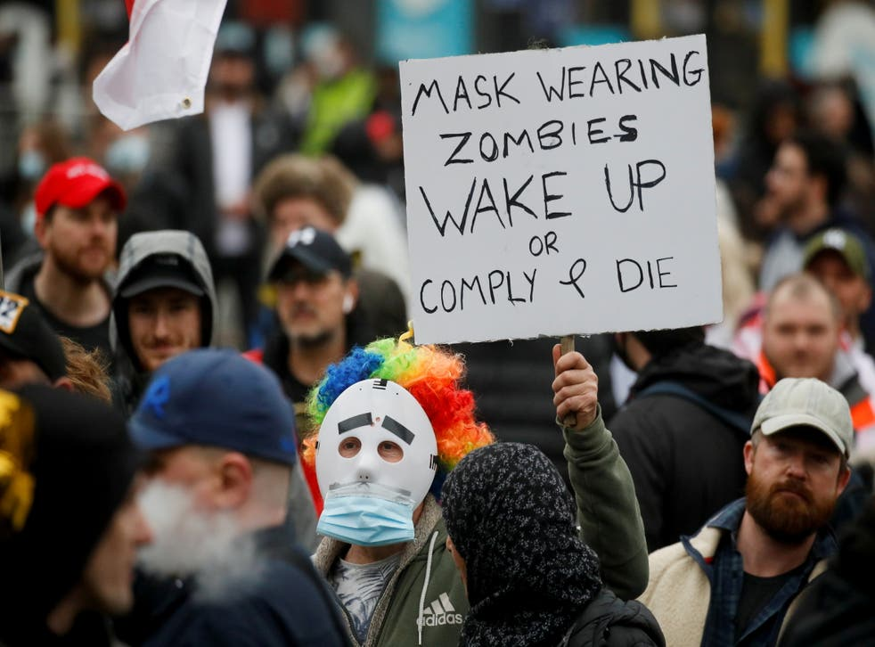 <p>People march in a protest against the lockdown in Manchester on Saturday</p>