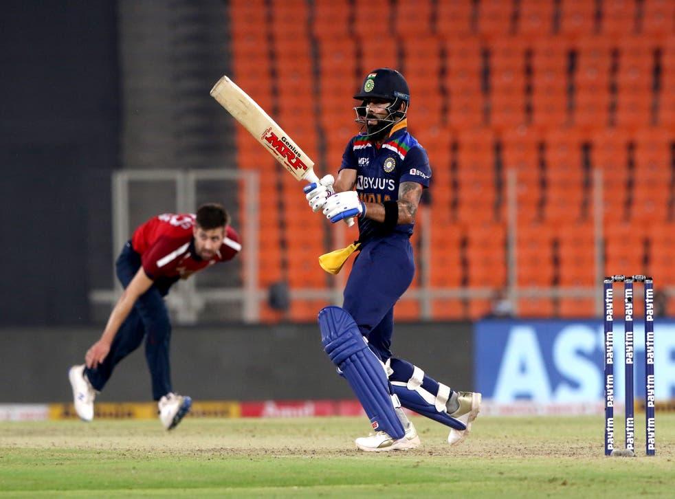 Virat Kohli plays a shot off Mark Wood's bowling