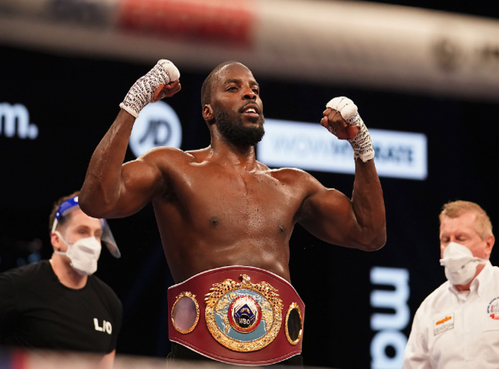 <p>Lawerence Okolie celebrates beating Krzysztof Glowacki for the WBO crusierweight world title</p>