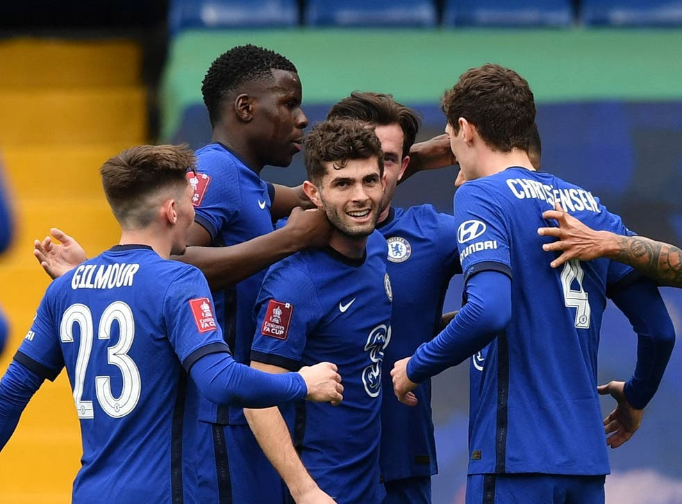 Chelsea players celebrate after Oliver Norwood's own-goal