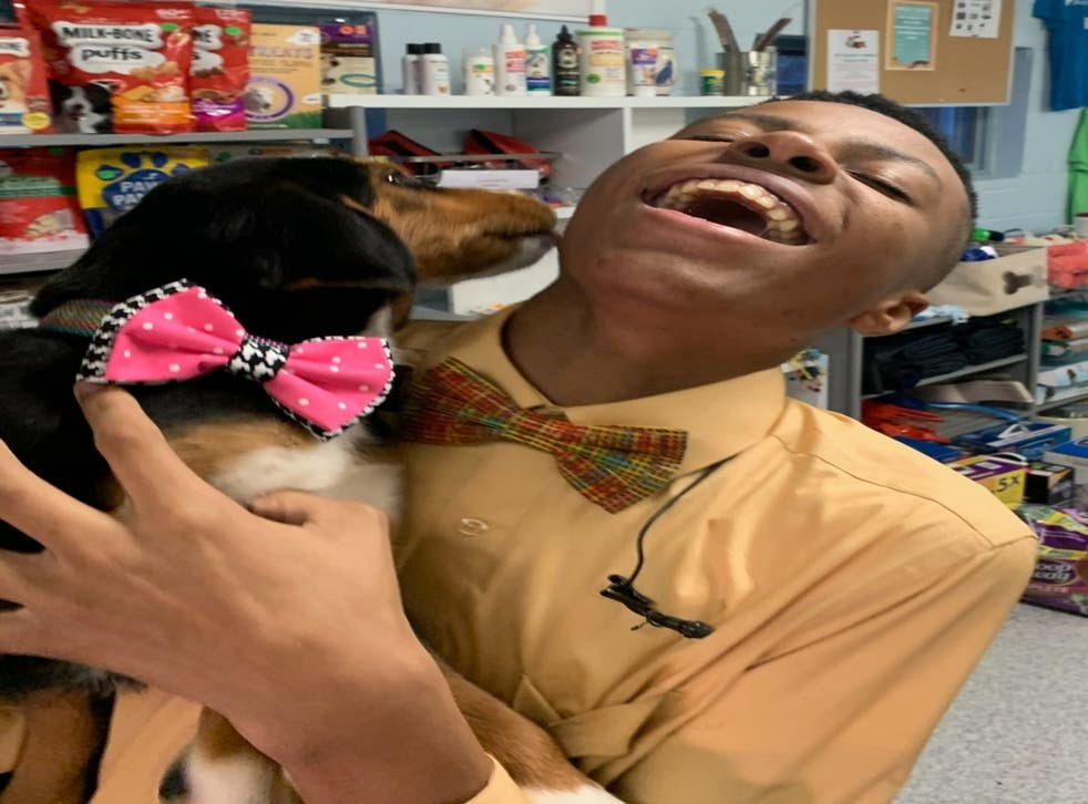 Darius Brown and a dog with a bow tie