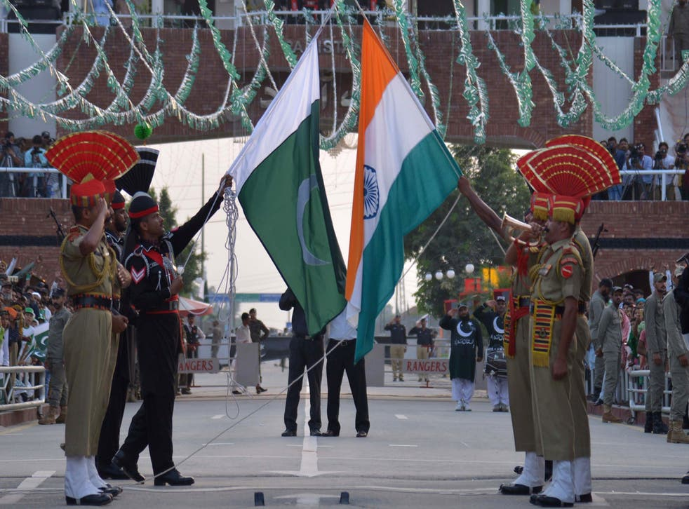 <p>File: Indian Border Security Force personnel and Pakistani Rangers perform flag ceremony at India-Pakistan Wagah border</p>