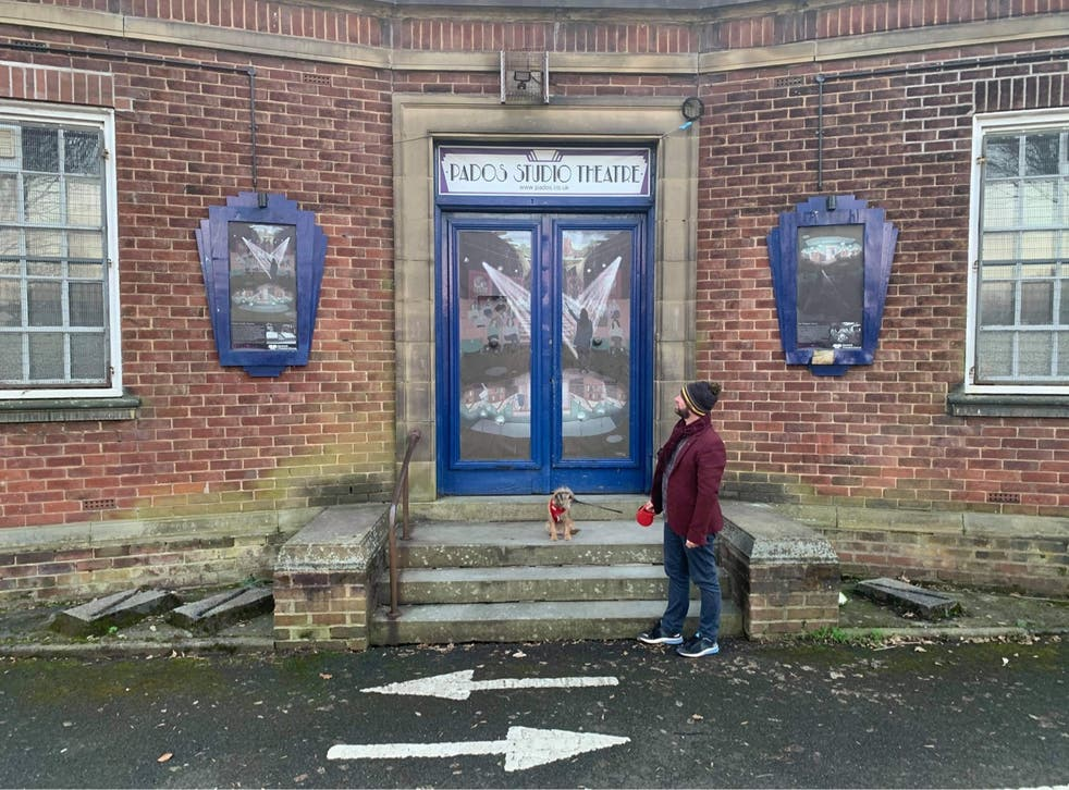 <p>Glen Clancy, a member of Pados, with dog Lola outside Prestwich Studio Theatre</p>