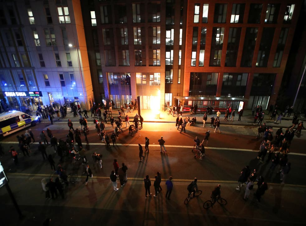<p>A bin is set on fire and explodes during riots in Bristol on Sunday</p>