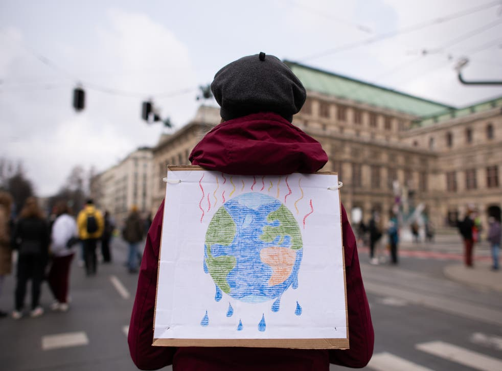 A sustainability scientist has urged the world's top consumers to take responsibility for their emissions
