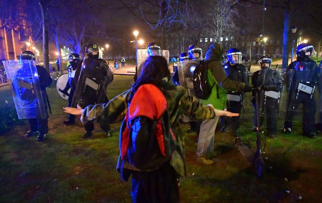 <p>Police and protesters at College Green in Bristol where police said around 130 people had gathered earlier in the evening</p>