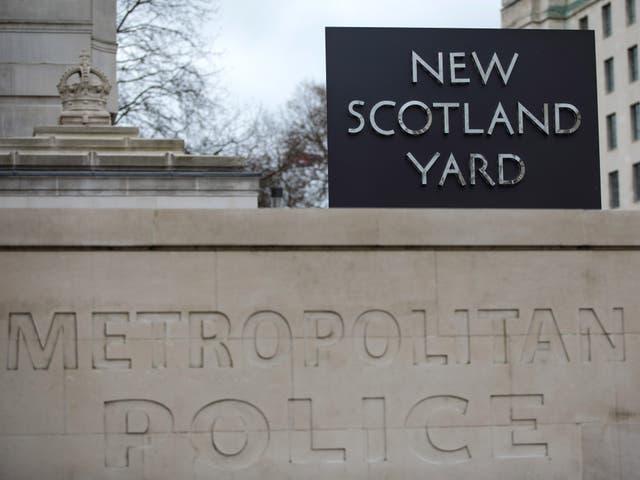 The New Scotland Yard logo outside the Metropolitan Police headquarters in London