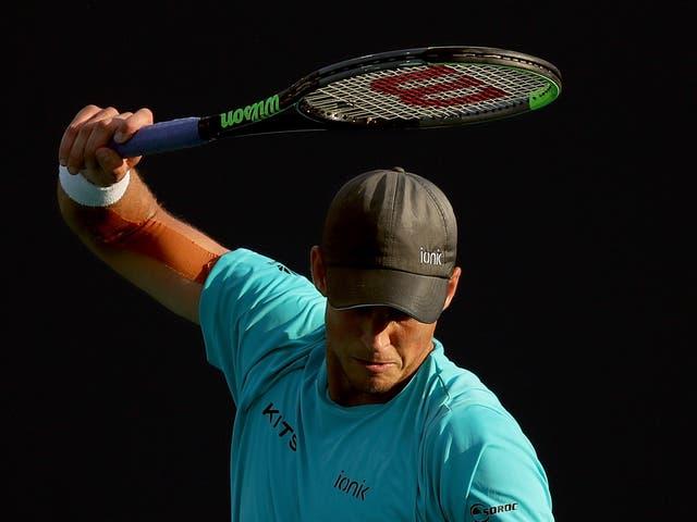 Vasek Pospisil of Canada winds up to smash his racquet