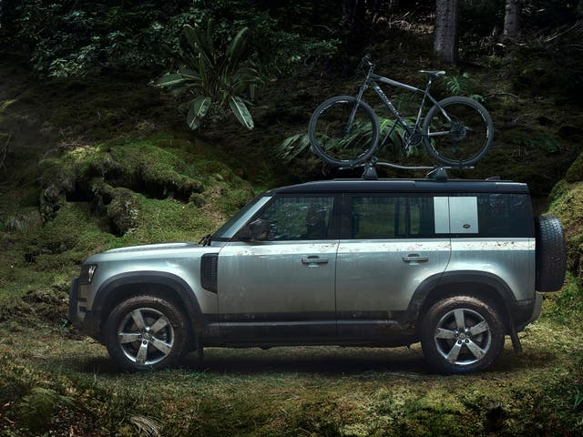 <p>A British institution... though the Land Rover is assembled in Slovakia rather than Solihull these days</p>