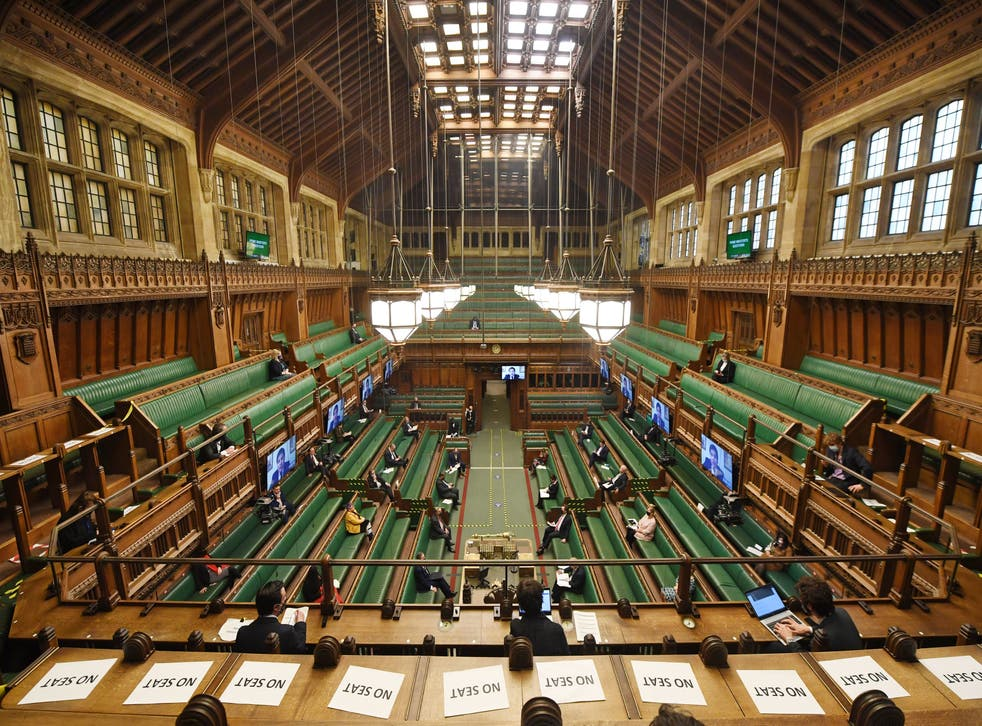 <p>A half-empty, sterile House of Commons chamber</p>