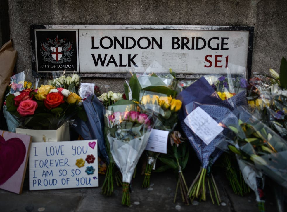 Floral tributes are left for Jack Merritt and Saskia Jones, who were killed in a terror attack on 29 November 2019