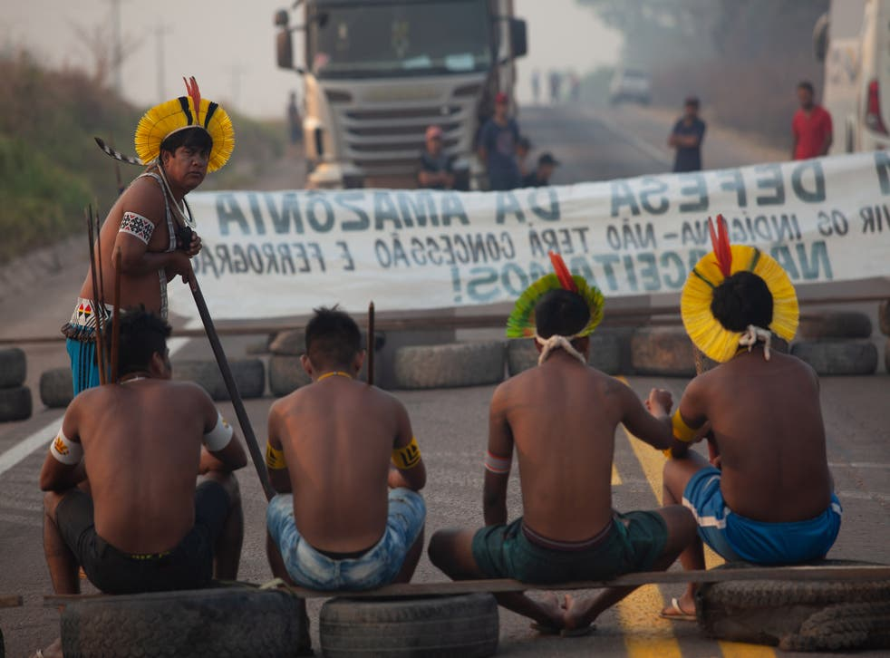Members of the Kayapo indigenous people block a highway in Brazil