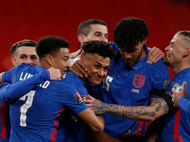 <p>Ollie Watkins is congratulated by his England teammates</p>