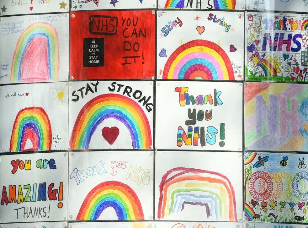Rainbow signs painted by students in the window of the DLD College across the road from St Thomas' Hospital in Central London (Kirsty O'Connor/PA)