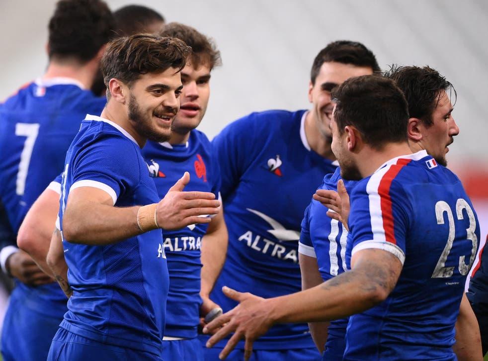 France centre Romain Ntamack (L) celebrates with Arthur Vincent