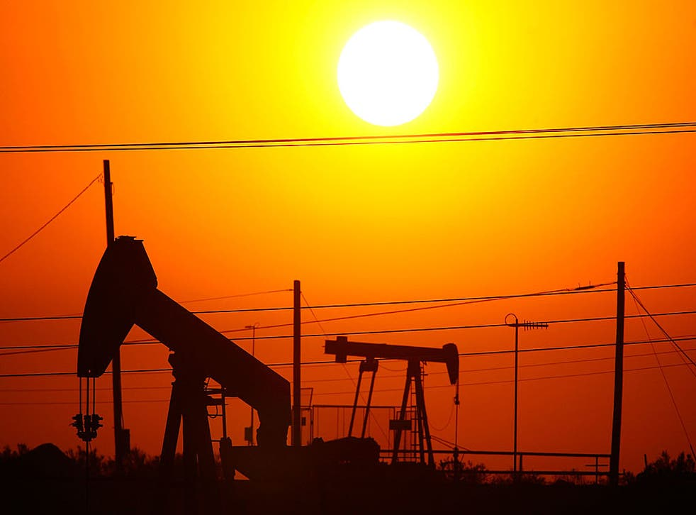 Oil rigs just south of town extract crude for Chevron at sunrise in Taft, California. The oil and gas industry's top lobbying group did a U-turn on carbon pricing this week