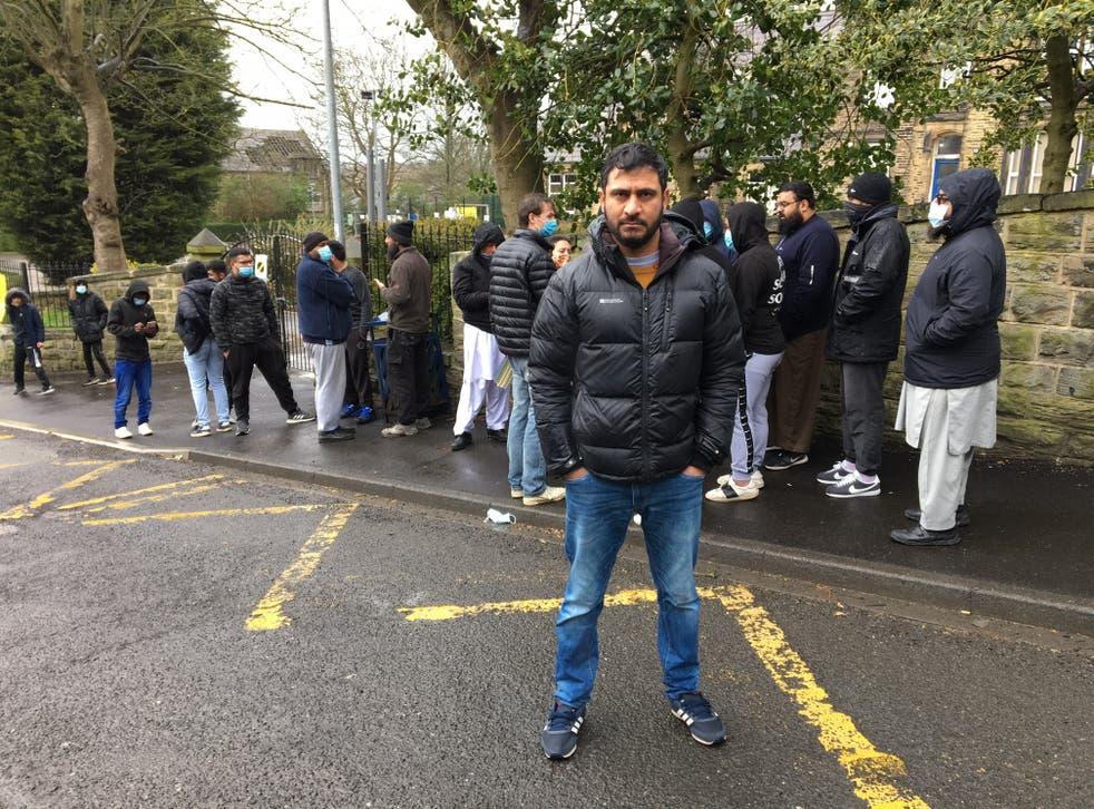 Binyamin Abbas stands in front of Batley Grammar School protests