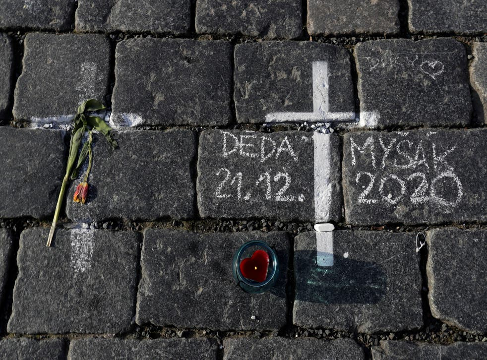 <p>Thousands of crosses have been painted on a pavement in Old Town Square to commemorate a year since the first Covid death</p>