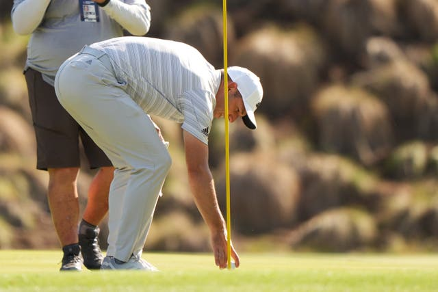 Sergio Garcia retrieves his ball after hitting a hole in one