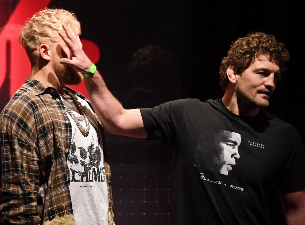 <p>Ben Askren shoves Jake Paul as they face off during a news conference</p>