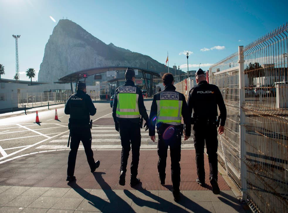<p>Police officers patrol the border between Spain and Gibraltar</p>