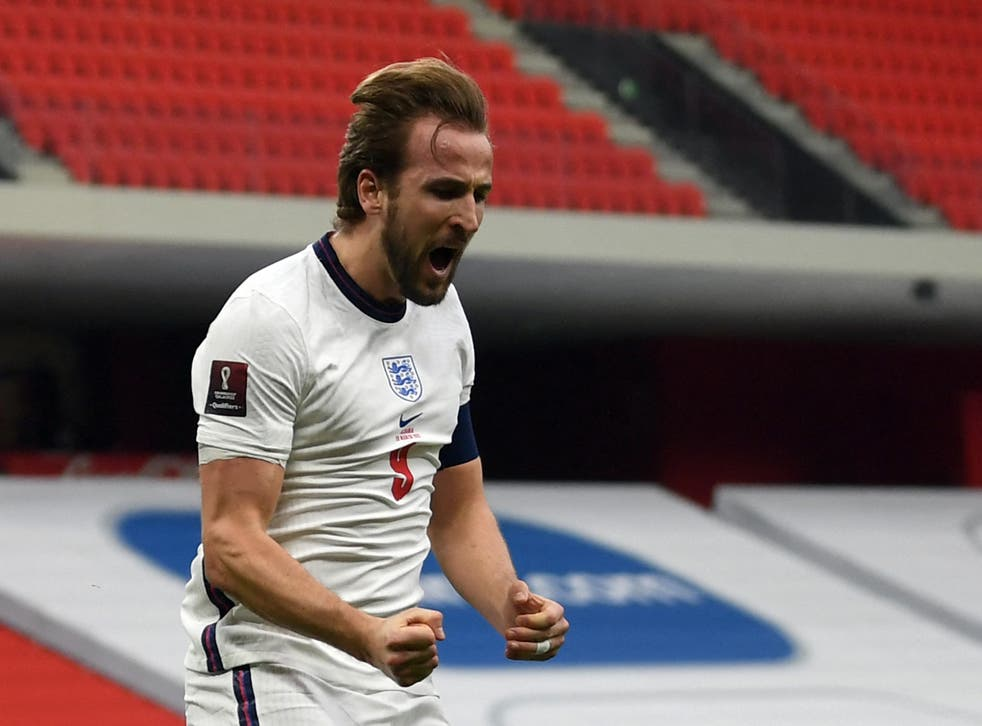 <p>Harry Kane celebrates opening the scoring</p>