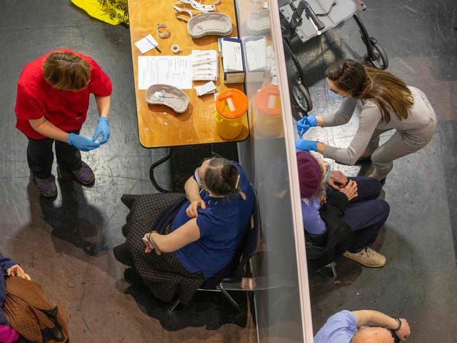 <p>Northern Ireland's first minister Arlene Foster receives her first Covid vaccination at Castle Park Leisure Centre in Lisnaskea, Co Fermanagh, on Saturday</p>