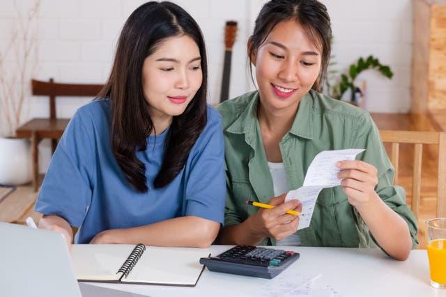Lesbian couple going through their savings goals