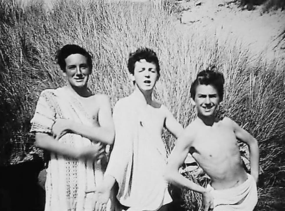 Paul McCartney and George Harrison on holiday in Harlech, North Wales, with John Brierley, pictured left