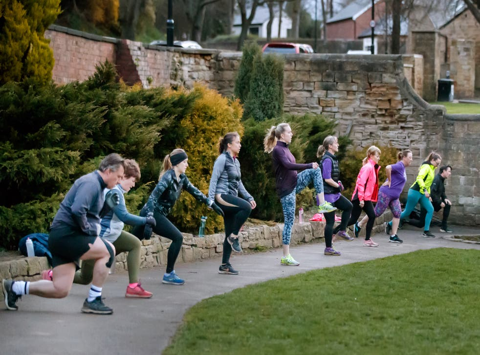 People take part in a bootcamp exercise class in Springhead Park, Rothwell, Leeds