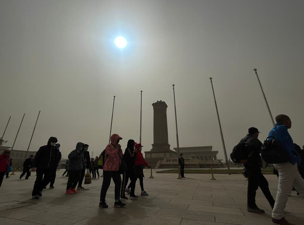 <p>The sky has swapped the colours around thanks to a sandstorm that is ravaging through the capital city</p>