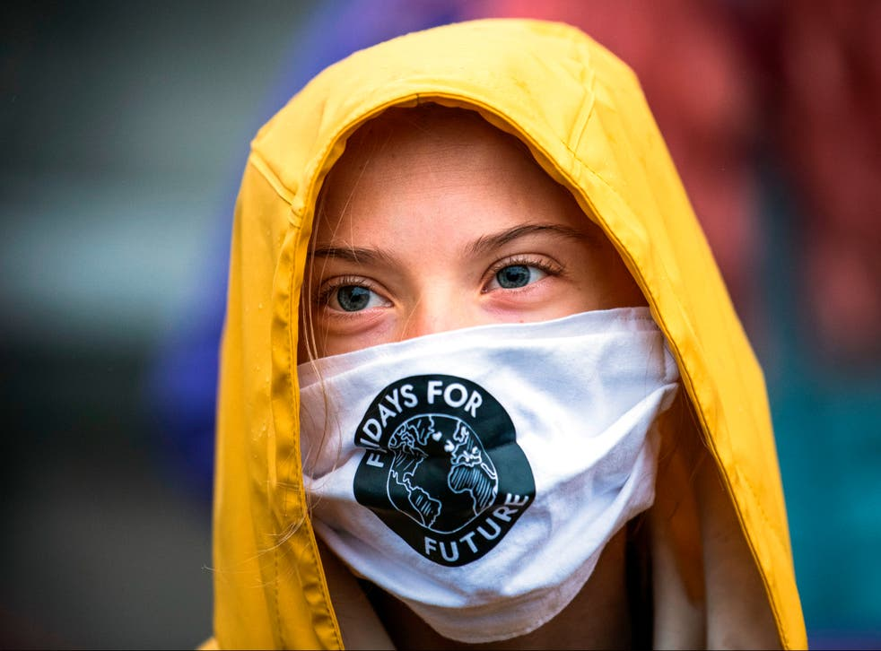 """Swedish climate activist Greta Thunberg is pictured during a """"Fridays for Future"""" protest in front of the Swedish Parliament Riksdagen"""