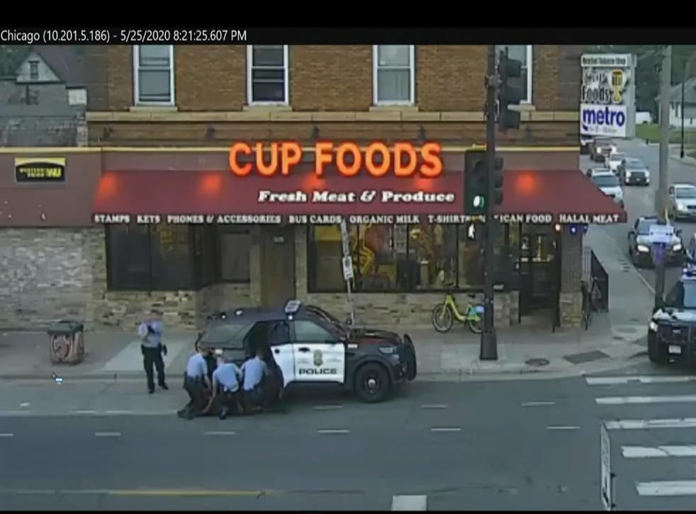 <p>A city-operated security camera shows officers kneeling on George Floyd's back during his fatal arrest.</p>