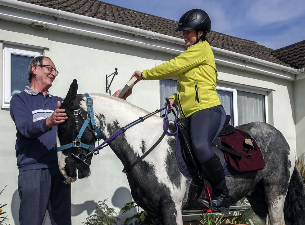 Rescue pony Micky helps owner Abi Eliot-Williams deliver library books to the Hullavington Book Group