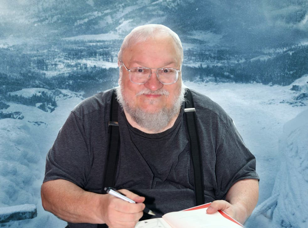<p>The 'Game of Thrones' mastermind with his (ahem) diary</p>