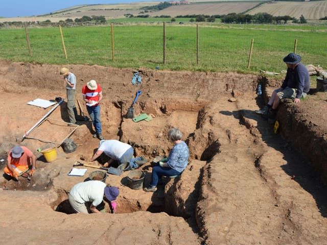 <p>Archaeologists, near Loftus, Yorkshire, excavating western Europe's earliest known salt-manufacturing complex</p>