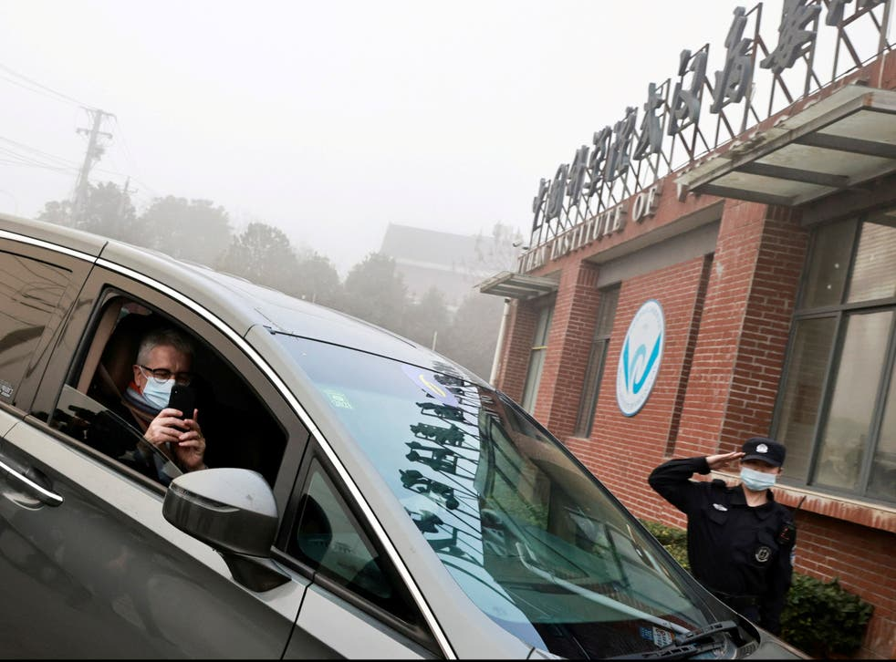 Dominic Dwyer, a member of the World Health Organization (WHO) team tasked with investigating the origins of the coronavirus sits in a car arriving to Wuhan Institute of Virology in February 2021