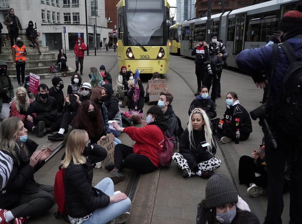 <p>Demonstrators block the tram tracks during a 'Kill the Bill' protest in Manchester City Centre on 27 March, 2021</p>
