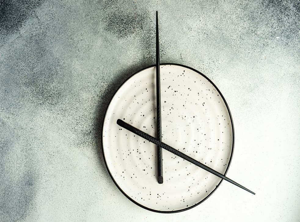 Empty plate with chopsticks making it look like a clock